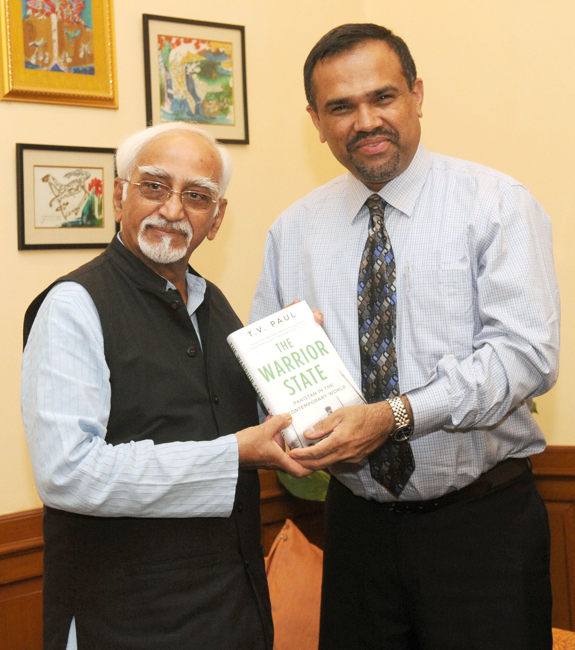 "T.V. Paul presents a copy of ""The Warrior State: Pakistan in the Contemporary World"" to Mohammad Hamid Ansari, Vice President of India, in New Delhi on June 13, 2014."